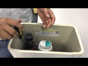 How to Adjust the Water Level in a Kohler Toilet Bowl - Cover the water tank